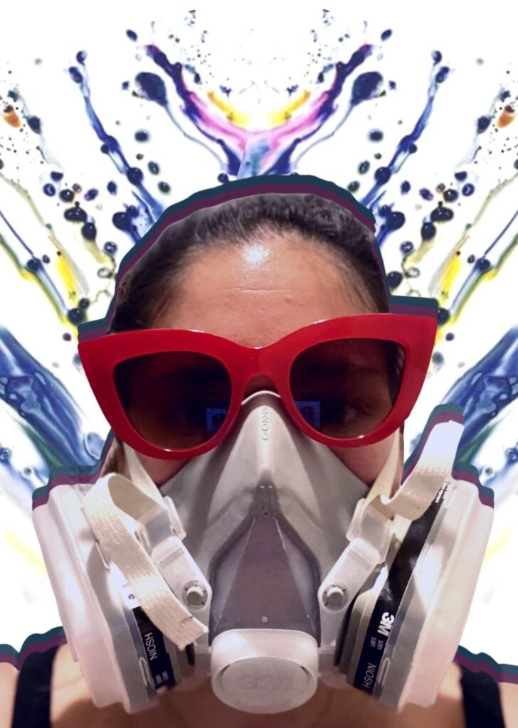 Kate Ackerman wearing industrial safety mask and fashion sunglasses as a protective measure while hand dyeing apparel for her Etsy shop, Yuiitsu Dye Shop